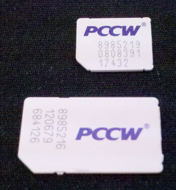 A micro SIM card (top) and a mini SIM card (bottom) compared