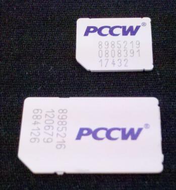 A micro SIM card (top) and a mini SIM card (bottom) compared