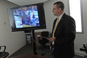 President Obama carries an Apple iPad under his arm (L), while ATF chief Vanderplow connects an iPad to a television monitor