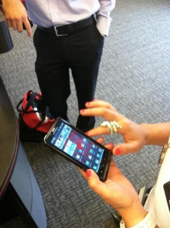 The Motorola DROID Bionic at home in a Verizon store with the optional webtop dock (R)