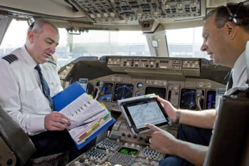 At UAL, 11,000 pilots have replaced paper manuals and charts with the Apple iPad