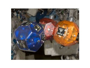 The trio of SPHERES controlled by the smartphones - Google Nexus S working hard on the space shuttle