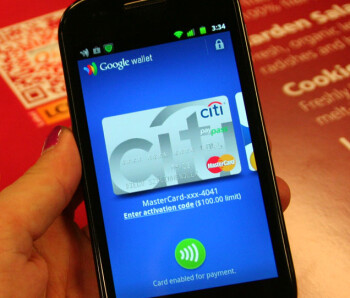 Google Wallet gets demoed (L,C) while MasterCard displays its QkR technology (R)