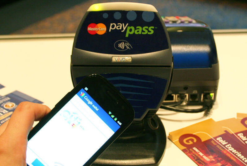 Google Wallet gets demoed (L,C) while MasterCard displays its QkR technology (R) - Google Wallet demoed by Master Card