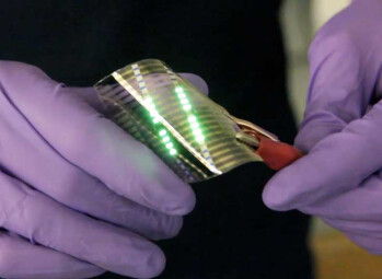 The plastic OLEDs are more impact-resistant than glass ones, and can be done on the cheap