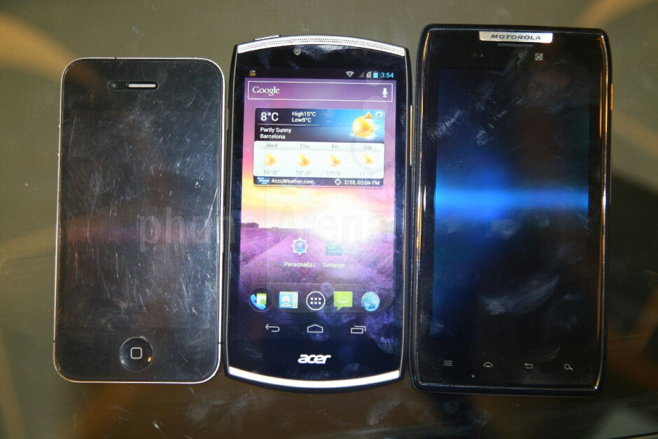 Left to right - Apple iPhone 4, Acer CloudMobile, Motorola DROID RAZR - Acer CloudMobile Hands-on Review