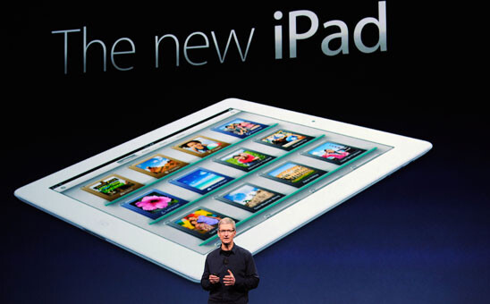 """Tim Cook (L) introduces the new Apple iPad (R) - Apple says demand for its new iPad is """"off the charts""""; stock held for pre-orders all sold"""