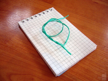 Attach the sketch pad to the phone with a piece of string