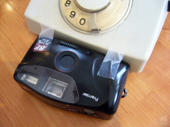 Attach a camera to the phone with scotch tape