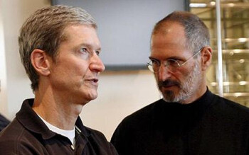 Apple CEO Tim Cook and his predecessor Steve Jobs at right