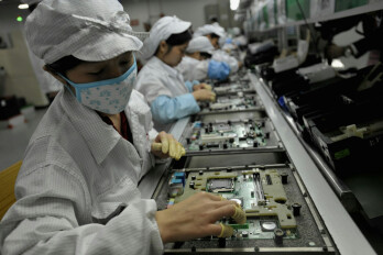 Foxconn workers doing what they do best
