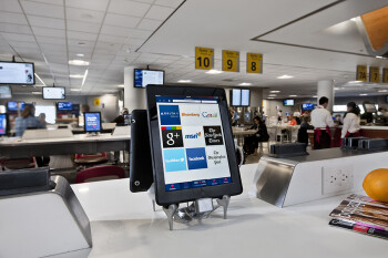Layout of an OTG eatery with Apple iPads (L) and the company's app