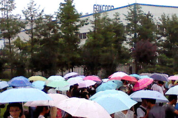 Thousands of hopefuls wait on line in Chengdu, China seeking a summer job assembling the Apple iPhone