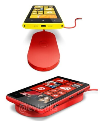 The wireless charging pad for the new Nokia Lumia models (L) and  a Bluetooth headset