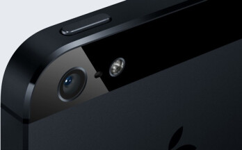 The third mic on the iPhone 5 is between the camera lens and the LED flash on the back