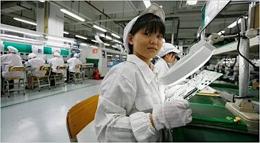 A Foxconn factory worker - Foxconn workers go on strike to protest working conditions while assembling the Apple iPhone 5
