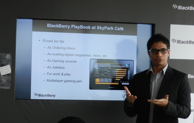 At the SkyPark Cafe, BlackBerry PlayBooks are used by waiters (L) while a tablet powers the juke-box - India's first BlackBerry themed cafe is the SkyPark