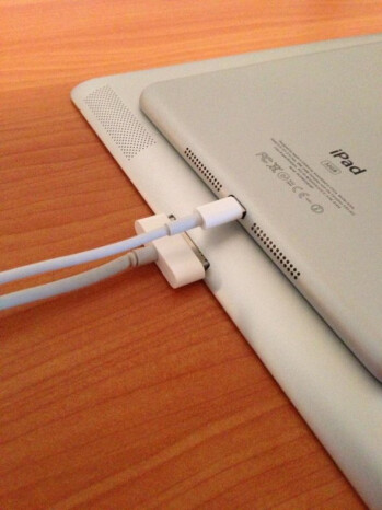 The new lightning connector on top with the older cable on the bottom