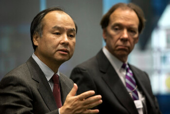 Softbank's Son (L) and Sprint's Hesse are still hungry to deal