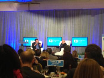 On stage, Steve Ballmer is interviewed by Reid Hoffman