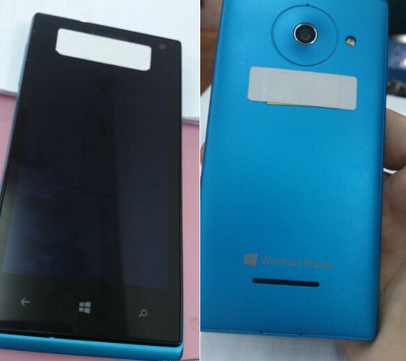 The phone in Nokia-ish cyan - The Windows Phone 8 Huawei Ascend W1 is pictured in color, in black and white