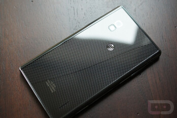 The Google Nexus 4 and AT&T LG Optimus G with cracked glass backs