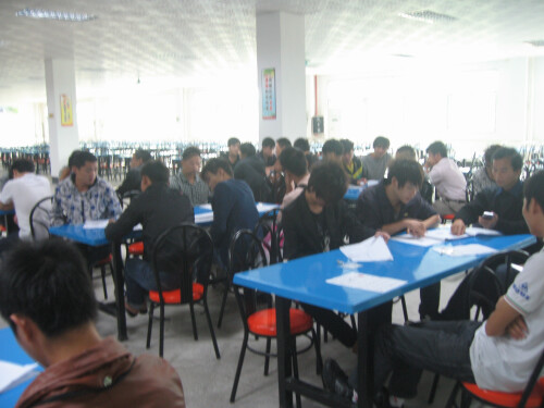 Prospective workers filing out forms