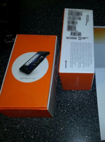 Dummy BlackBerry Z10 for AT&T (L) and the boxing for the phone from the carrier