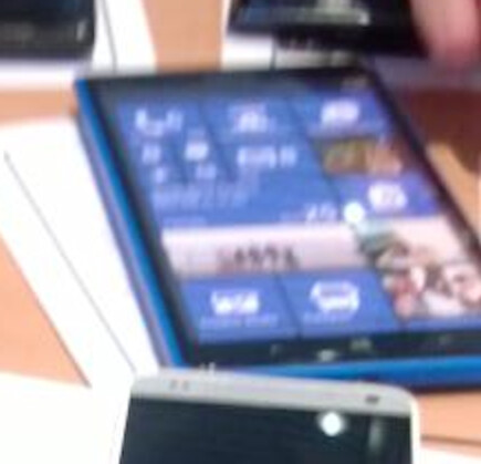 The rumored Nokia Lumia phablet with a closeup (L) - Blurry picture of alleged Nokia Lumia 1030 reveals Windows Phone phablet