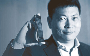 Huawei CEO Richard Yu holding the world's slimmest smartphone the Ascend P6