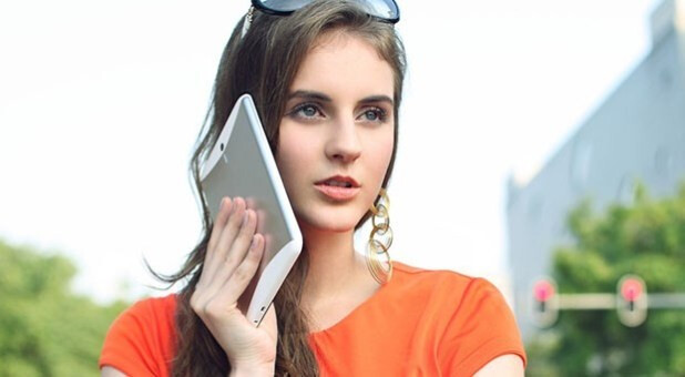 """The Huawei MediaPad 7 Vogue dwarfs a user's ear when making a call - Huawei introduces Android """"call-enabled"""" tablet with 7 inch screen"""