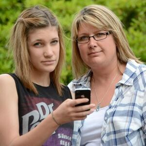 Casey Snook (L) ran up a $6000 cellphone bill from her trip to New York City