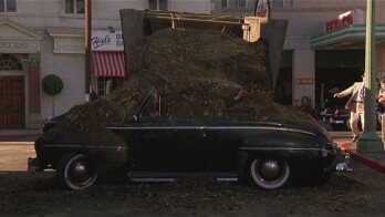 Real life follows fiction as this scene from Back to the Future shows Biff Tannen covered with manure after he drove his car into a trailer loaded with the stuff