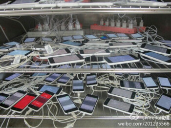Is this picture showing a us a bunch of plugged-in Apple iPhone 5C units at Pegatron?