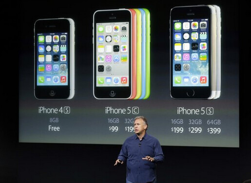 Apple's Philip Schiller stands in front of pricing information for Apple's new line up - Investors dump Apple shares, wanting a lower price for the Apple iPhone 5C
