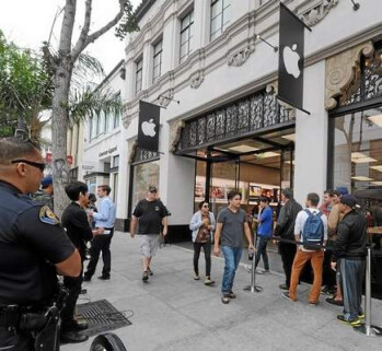 The line outside the Pasadena Apple Store, contained some homeless people paid to sit on line and purchase two Apple iPhones
