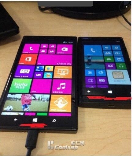 Nokia Lumia 1520 phablet spotted again, sized up with another Windows Phone and an iPhone
