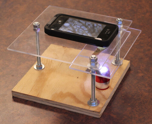 An iPhone on top of the DIY microscope