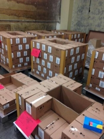 Lots of Nexus 5 boxes pictured in an LG distribution center