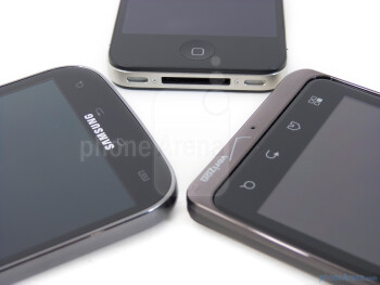 Front buttons - Samsung Galaxy S II for T-Mobile (left), Apple iPhone 4S (bottom, top) and Motorola DROID BIONIC (right) - Apple iPhone 4S vs Motorola DROID BIONIC vs Samsung Galaxy S II T-Mobile
