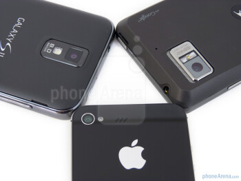 Rear cameras - Samsung Galaxy S II for T-Mobile (left), Apple iPhone 4S (bottom, top) and Motorola DROID BIONIC (right) - Apple iPhone 4S vs Motorola DROID BIONIC vs Samsung Galaxy S II T-Mobile