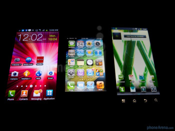 Left to right - Samsung Galaxy S II for T-Mobile, Apple iPhone 4S and Motorola DROID BIONIC - Apple iPhone 4S vs Motorola DROID BIONIC vs Samsung Galaxy S II T-Mobile