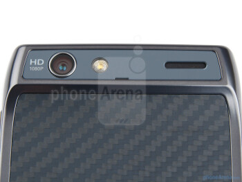 The rear camera with LED flash and the speakerphone grill are stuffed into the handset's hump - Motorola RAZR Review