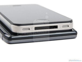 Bottom edges - Motorola DROID RAZR (bottom) and Apple iPhone 4S (top) - Motorola DROID RAZR vs Apple iPhone 4S