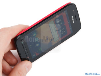 "The Nokia 603 comes chubby at 0.5"", but  its tapered edges and sloping corners make it pretty ergonomic and easy  to hold - Nokia 603 Review"