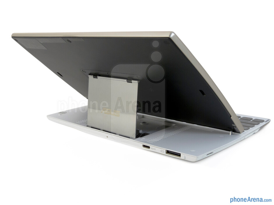 Accessing the keyboard is accomplished by pulling the top edge of the tablet - Asus Eee Pad Slider Review