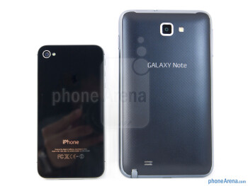 Backs - The Samsung Galaxy Note LTE (right) and the Apple iPhone 4S (left) - Samsung Galaxy Note LTE vs Apple iPhone 4S
