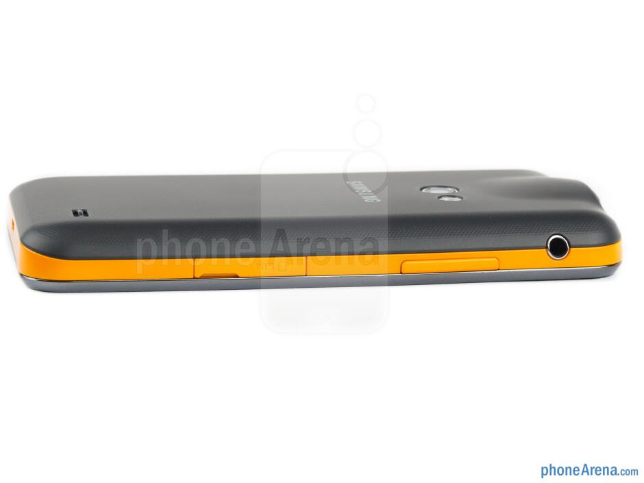 SIM card slot, 3.5mm jack, volume rocker (left) - The sides of the Samsung Galaxy Beam - Samsung Galaxy Beam Preview
