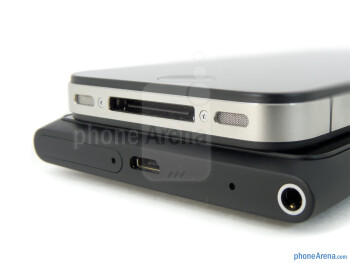 Connection ports - The Nokia Lumia 900 (bottom) and the Apple iPhone 4S (top) - Nokia Lumia 900 vs Apple iPhone 4S