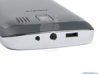 3.5mm jack, charging and microUSB ports (top) - The sides of the Nokia Asha 302 - Nokia Asha 302 Review